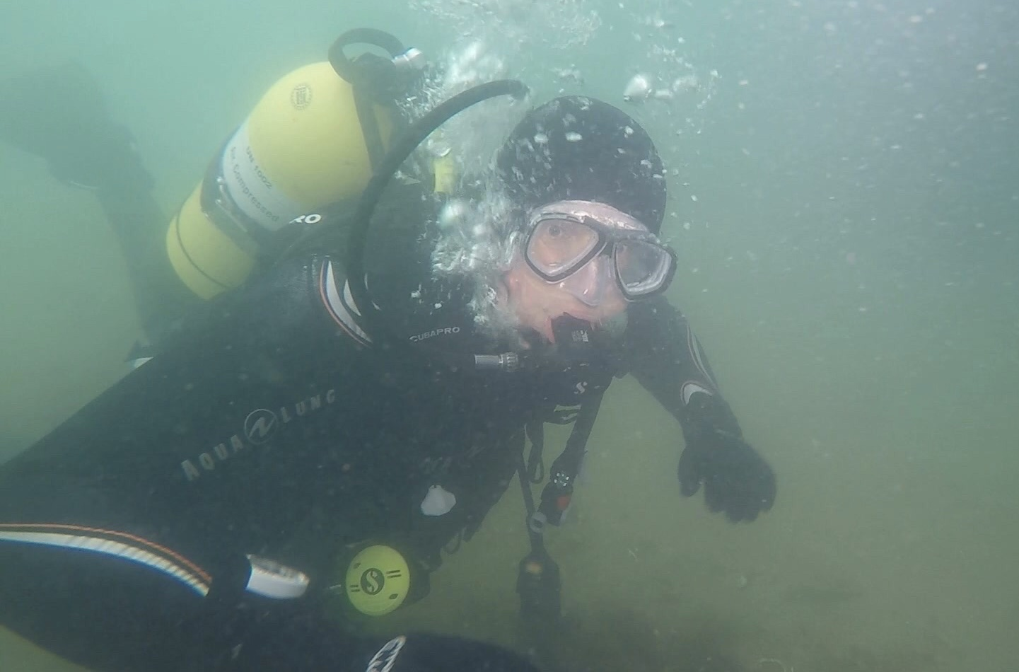 Giles on his first UK sea dive under Swanage Pier